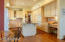 FABULOUS LAYOUT OF THE KITCHEN WITH MANY CABINETS, BUILT-IN DESK AND PANTRY