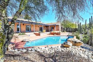 Gorgeous backyard perfect to entertain and relax under the covered patio or in your sparkling pool. South facing, ideal, and romantic city light views after sunset!