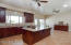 Gourmet kitchen with large island and buffet table.