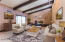 Virtually Staged - Formal Din/Liv Rm Combo w/ fireplace and access to courtyard.