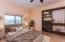 Virtually Staged - Bedroom 3 w/ built-in shelving. Views to private sports court.
