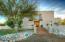 Front view of 4520 N. Flecha Dr., brick walkway to custom wood door entryway,