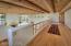 Loft landing of master bedroom suite. Wide enough to create library, office, sitting room. Hard wood floors. See great room below. French door entry to sitting room portion of master suite.