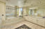 Very spacious master bathroom. Dual sinks, jacuzzi tub, separate shower. All in bright white Talavera handpainted tile including floor. Room for bathroom chaise lounge.