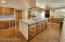 Enormous kitchen, custom cabinets, hand painted talavera tile counters, island, plus sit up kitchen breakfast bar overlooking great room.