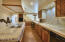 Significant counter and storage space in oversized kitchen. Walk in pantry.