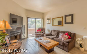 Main Living Area has Corner Fireplace, Flat Screen TV & patio Entrance. Remodeled Tile Flooring.