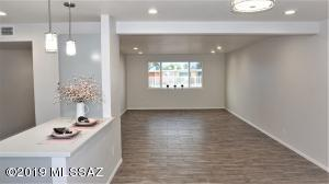 Wood look Ceramic plank flooring in all the living areas, kitchen, and bathrooms