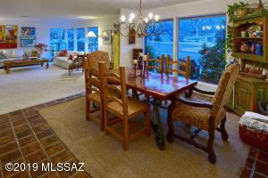 """This is the """"formal"""" living room and dining room. We like it best to have game nights with friends."""
