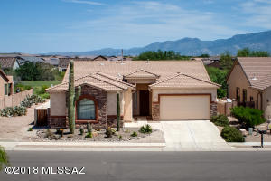 Beautiful Home with great views of the Catalina Mountains. Open area on the left side.