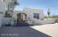 White stucco shines on this Old Foothills Santa Fe Home.