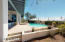 HEATED POOL AND SPA with flower beds surrounding the yard.