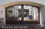Enter these custom made courtyard gates to this fine estate.