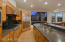 The kitchen has expansive granite counters, a gas cook top, double sink, vegetable sink and a large pantry.