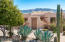 It's a Hacienda Style home with 4 bedrooms and 3.5 baths, a 3 car garage and a Panoramic Mountain View.