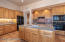 Custom wood cabinets with granite counters and GE Profile Appliances in the kitchen.
