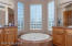 Master bath with duel vanities and large soaking tub with jets.