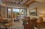 Family room with breakfast area and stone fireplace
