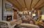 Beamed ceilings, custom sandstone fireplace, cantera stone floors