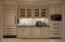 Sleek appliance wall w/custom cabinetry, sub zero, refrigerator drawers, warming oven, steam oven & more