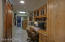 Great office area, pantry w/barn door, and laundry in back