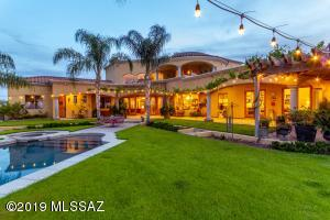 Expansive covered patio and luxury back yard oasis.