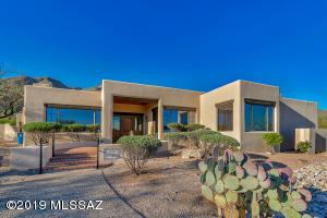 Front of house, with walkway and mesquite front door
