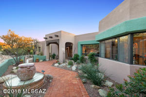 The front yard is private with a fountain and courtyard entry. Mountain views to your left.