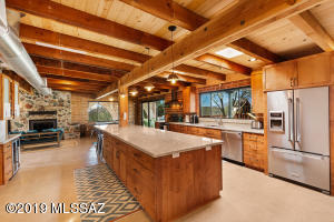 Mahal quartzite countertops, a 16 foot island, and top-of-the-line appliances.