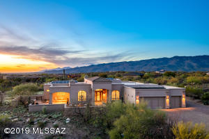 Picturesque sunset & mountain views. 4BR, 3 1/2BA + den/office 3,701 Sqft.