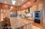 "Gourmet kitchen hosts 42"" hickory cabinets, Huge center island, granite & top of the line stainless steel appliances"