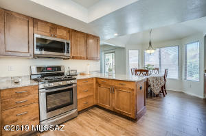 Enjoy the Remodeled Kitchen with Stainless Steel Appliances, Marble Counters, and Maple Cabinets with Soft-Close
