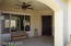 L shaped covered front porch with ceiling fans