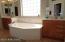 Two separate vanities and deep garden bath