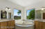 Separate vanities, Jetted tub with city/mountain views