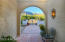 Enter through an exterior arched foyer