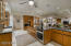 Custom designed kitchen- two ovens, double sink, flat top induction cook-top.