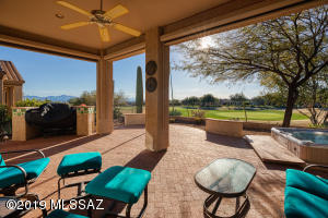 3rd hole putting green view Indoor outdoor living with electric rolling shades