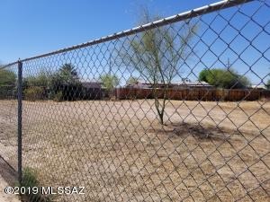Beautiful fenced in lot with mature vegetation.