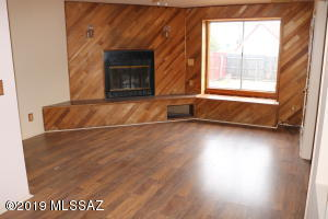 Living room with wood burning firepace.