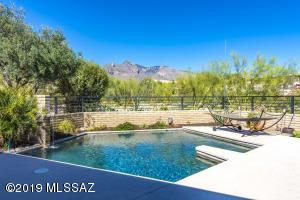 Gorgeous Mountain Views from Your Modern Designed Backyard and Sparkling PebbleTec Pool! Complete with Water Feature Peacefully Spilling Into The Pool. (pictured at left)