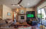 Family Rm/Great Rm with stone fireplace & custom reclaimed wood fireplace mantel.