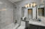 Guest bathroom with Carrera marble deco strip, tile and countertops