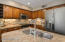 Granite countertops, stainless steel appliances, and new dimensional stacked stone, marble, glass backsplash
