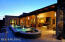 Raised lap pool with remote controlled fountains and colored lighting.