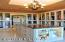 """Elegant """"closet"""" with central island with 2 custom """"triple-dressers"""" built back-to-back serves as packing station, too."""