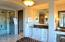 Master bath includes gracious makeup vanity and lighted art niches at each vanity.