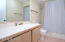 Guest bath # 2 near bedrooms 2 and 3. See floor plan under Virtual Tour tab. Guest bath #3 near Bedroom 4 is similar. All bathrooms have a tub.