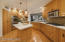 Center island with prep sink, double ovens. walk in pantry + stand up desk area.