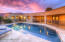 Separately fenced pool, covered patios and built in BBQ